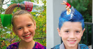 Boy and girl showing crazy hair styles